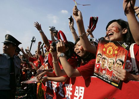 Fans of Manchester United cheers during a promotional event in China's southern city of Guangzhou